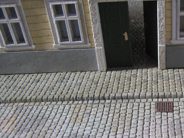 Bürgersteigplatte Kopfsteinpflaster